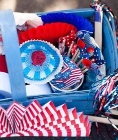 In true Fourth of July spirit, fill a basket or bucket with red, white, and blue trimmings. Visit the 99-cent store or your local party store and load up on all sorts of inexpensive, what-would-you-need-this-for? items. We're talking about paper pinwheels, flag picks, and streamers.