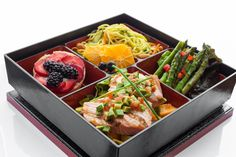 Bento Box Entrée: Salmon Filet with Avocado & Diced Tomato  Set on Avocado and Papaya Sauce  Side: Sesame Lo Mein Noodle Salad with Carrot, Cucumber, Scallions, Cashews & Cilantro Tossed in Sesame Oil & Rice Wine Vinaigrette  Side: Grilled Asparagus Spears   Dessert: Fresh Fruit Tartlets