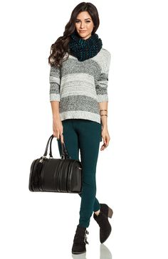 Crawling back into your warm bed is especially tempting in winter but this teal scarf and skinnies will keep you just as warm. Add a grey striped sweater and ankle boots for a cozy look.