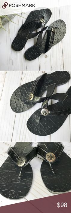 "Tory Burch Thora black silver leather flip flop Black patent leather Tory Burch Thora sandals with silver-tone logo emblem, tonal stitching and rubber soles.  Heels: 0.25"" Condition: Very Good. Light creasing at uppers; light scuffing at soles. scuffing on the left toe area (can't see when wearing) Tory Burch Shoes Sandals"