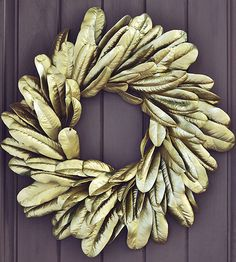Find a magnolia leaf wreath and turn on the glitz with some metallic spray paint! Find more fall wreaths here: http://www.bhg.com/thanksgiving/outdoor-decorations/holiday-wreaths/?socsrc=bhgpin110514goldmagnoliawreath&page=2