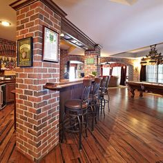 Love the wood floor and the brick pillars!  Gorgeous! Would be cool on a basement bar. Another great way to hide basement supports in LL.
