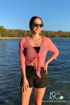 A staple perfect for any and every occasion! Super lightweight mesh that folds down to a compact size to fit in your purse and will never wrinkle. Easy enough to simply throw on and go! Layer over a summer dress, jeans or shorts and enjoy all year-round! Island Style Clothing has many colours to choose from. #luau #cruisewear #summer #beachcoverup #bolero #beachcardigan #cardigan #over-swim #lightweight #red #throwover #fahsion #staplepiece #women #shrugs #shrug #shortsleeve #sheer #onesize #tie