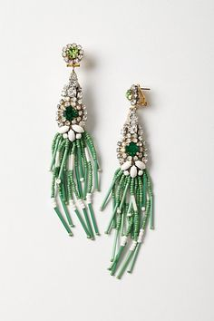 Grass Skirt Drops Taking inspiration from everywhere under the sun - vintage markets, Italian piazzas, far-flung locales that she's visited on holidays - and focusing on quality and craftsmanship, Daniela Ravaioli has designed the Rada collection for more than twenty years. Grass-green beaded tassels sway in the breeze on this Swarovski crystal-encrusted pair. #anthropologie