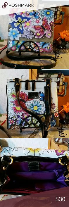 Handpainted.Sharif. A total of 9 pockets, plus pockets for phone & cards . zippered around the purse. Sharif  Bags Crossbody Bags