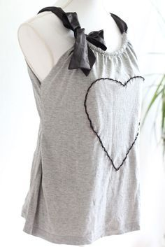 Upcycle tshirt into ribbon tank top- would look really cute with a fancy pink ribbon and my I  Boobies T-shirt for the 3-day walk :)