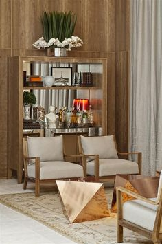 geometric copper tables make the space.