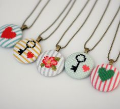 Floral Cross Stitch Pendant Necklace. $30.00, via Etsy.
