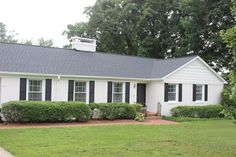 long white ranch with a gray roof - just like ours.  we need shutters for contrast and to break up all that white