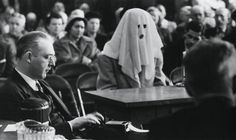 A cured narcotic addict testifies at the Washington State crime investigation committee. The witness was allowed to wear a hood to conceal his identity while testifying on the narcotic traffic in Washington ca. April 30th 1952 [1024611]