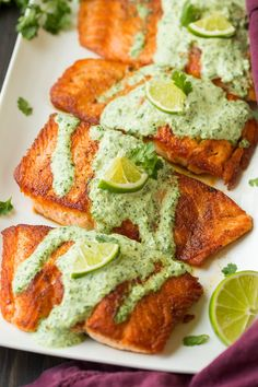 Quick and easy spice rubbed salmon seared in a skillet and topped with a rich and vibrant cilantro lime sauce! Perfect for dinner any day of the week!