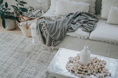 Boho Chic inspired living room / A mix of organic textures / Grays and muted colors / IKEA Söderhamn sofa with a Bemz Rosendal Pure Washed Linen slipcover in Unbleached