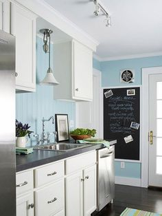 White kitchen & Black countertop - Pale blue is a cheery accent color for a cottage-style kitchen! See the rest of this kitchen makeover: BHG kitchen Kitchen Remodel, Cottage Style Kitchen, Blue Kitchen Designs, Kitchen Colors, Stock Kitchen Cabinets, White Kitchen Cabinets, Blue Kitchens, Kitchen Styling, Kitchen Makeover
