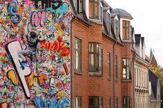 By Martin Whatson in Aalborg, Denmark Street Art Utopia, Street Art Graffiti, Little Green House, Aalborg, High Walls, Red Roof, International Artist, Street Artists, Gray Background