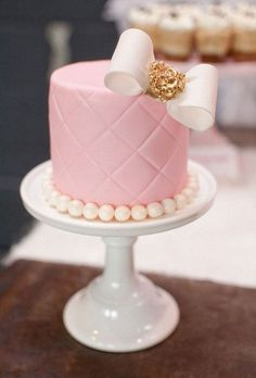 pink quilted cake with bow and pearls