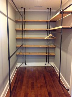 I LOVE my new closet! Re-purposed wood and pipe fittings (plus a few things from the hardware store) = a fabuluosly industrial style chic closet. Inspired by domestiphobia.net and courtesy of my GC. *Notice that you can't stub your toe on the pipe AND a dust mop sweeps right through easily! #minimalist #DIY #industrial #closet