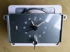 NOS 1956-1957 Lincoln Clock Capri, Premiere Classic Car clock fits hot rods and rat rods and many vintage autos. This classic car clock is a vintage auto part.