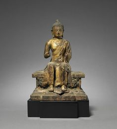 Figure of a Maitreya on a Tiered Pedestal, c. 1200  Nepal, late 12th-early 13th century  gilded wood with polychrome, Overall: 21.3 x 14.6 cm The pendant legs of this image indicate that he is the next historical figure to achieve enlightenment and spread Buddhist teachings in a future time when the current historical Buddha's teachings will have been forgotten.