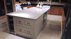 Why not have an island with integrated cooker and wine cooling fridge!