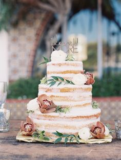 Rustic floral topped naked cake: http://www.stylemepretty.com/2015/11/30/classic-summer-wedding-at-the-adamson-house/ | Photography: Diana McGregor - http://www.dianamcgregor.com/