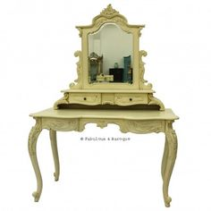 This fabulous French styled dressing tablewill transform your bedroom into the fabulous boudoirevery girl dreams of! Bring a touch of glamour to your bedroom with this substantial sized dressing table adorned withfour beautifully carved legs and 2 drawers, complete with a stunning mirror sitting on top of two smaller vanity drawers. Finished in a ivory lacquer finish.