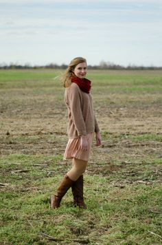 oatmeal sweater layered over a pink dress / red scarf / brown boots / outfit
