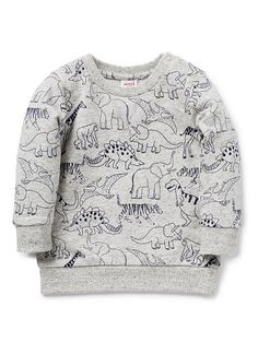 100% Cotton French Terry sweater featuring all over dinosaur yardage print. Snap fastenings on shoulder for easy dressing.