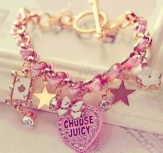 Beautiful gold charm bracelet, with pink white and gold charms