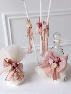 Oil set 5 pieces oil bottle, 3 candles and 1 scented soap bar), decorated with tulle, matching ribbons and pale pink handmade flowers. It is combined with the matching baptism dress from the Designer's Cat collection. Tulle Decorations, Baptism Dress, Handmade Flowers, Christening, Projects To Try, Bloom, Birthday Parties, Nursery, Candles