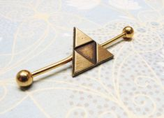This is a fantastic bronze triangle ear barbell, inspired by the Triforce from Legend of Zelda!Perfect for the gamer geek in your life!**OPTIONS: This bar comes in gold or green, horizontal or vertical - please see the photos for variations, and m...