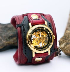 Satin Black & Oxblood Red Leather Cuff Mechanical Watch.    This is a beautiful 2 1/4 inch wide, multi-layered leather cuff watch with a