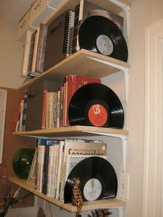 vinyl record bookends. The disc is placed in boiling water very carefully, and then with a piece of wood forced to fold.