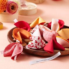 """Make Fortune Cookie Favors Fortune cookies are a favorite Chinese-inspired American invention. These DIY cloth fortune cookies are fun to make, and they are adorable party favors. Not feeling crafty? The traditional Chinese New Year gift is a red envelope with some """"lucky money"""" inside."""