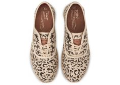 Adding a little sass to a basic jeans and white t-shirt outfit.     TOMS Black Snow Leopard Burlap Women's Cordones