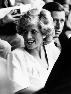 "July 13, 1985: Prince Charles & Princess Diana at the ""Feed the World"" Live Aid concert at Wembley Stadium.:"