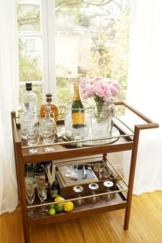 No matter if you and your roomie have the same group of friends or different buddies, you'll want to have some space for entertaining. A DIY bar cart is the best budget-friendly (yet chic) option for entertaining.