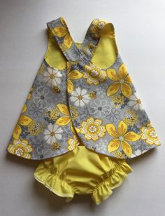 Best 10 I made this adorable pinafore and matching bloomers using cotton fabric. The bright daffodil yellow colour floral pattern on a light grey background is very cheerful. The yellow colour will make you smile. The pinafore dress can be reversed to pla Toddler Girl Outfits, Little Girl Dresses, Baby Frocks Designs, Baby Sewing Projects, Kids Wear, Baby Dress, Doll Clothes, Cotton Fabric, Kid Outfits