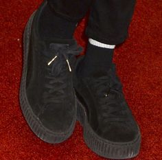 """Cara paired her H&M ensemble with the Puma x Rihanna """"Creeper"""" sneakers in black"""