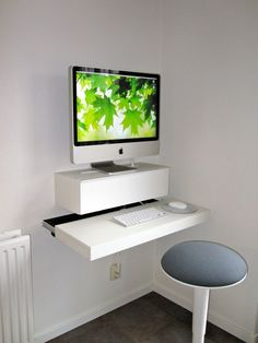 Here's a solution for all those space-challenged Ikea hackers out there (and aren't there so many!). This Dutch hacker took a shelf and a cabinet and mounted them to the wall, creating what might be the skinniest desk for an iMac ever built. The best part