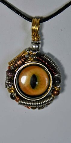 Cat eye pendant wirewrapped  with coils unisex gold by wedoart, $24.00