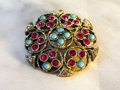 Sarah Coventry Rhinestone Brooch  Turquoise and Red rhinestones by GemstoneCowboy on Etsy