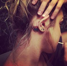 Tiny Behind The Ear Lotus Flower Tattoo