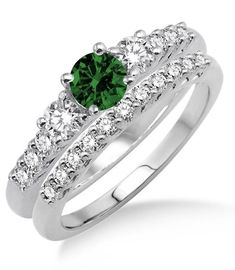 1.5 Carat Emerald & Diamond Trilogy Bridal set on 10k White Gold. The sparkle of Emerald Gemstone along with glittering diamonds in this beautiful Emerald and diamond engagement ring wedding set would make her fall in love. The inexpensive Emerald and diamond gemstone bridal ring would be an instant family haireloom.| Price: $569.00 USD on Shygems