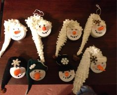 Snowman ornaments made from discarded battery operated votive candles