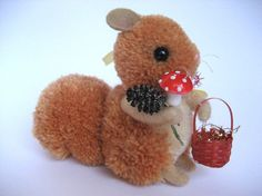 Yarn pom-pom squirrel with his woodland supplies :)