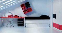 Modernos muebles en blanco y rojo para un dormitorio juvenil abuhardillado