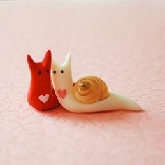 http://theknottybride.com/wp-content/uploads/2010/02/Valentine-snails-pink-background.jpg