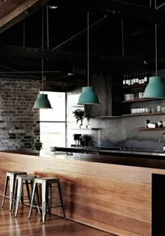 I love this industrial chic kitchen - don't you think those green pendant lights just finish it perfectly?