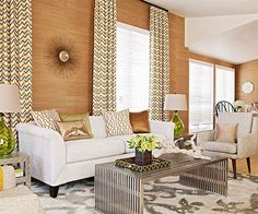 Smart tricks lend generous design props to this petite living room. Instead of using studio-size furniture, standard-size furniture in neutral colors is arranged strategically to take up less space and create a comfortable se