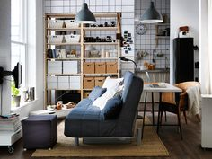 One-room living    Create different zones to maximise the space in your living room with a sofa-bed, bookcase, drawer units on castors and a curtained wardrobe.
